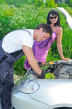 Mechanic measures lead acid battery Stock Photos