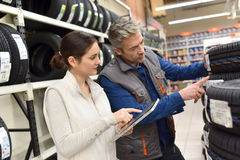 Mechanic with merchandiser checking on stock Stock Images