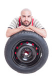 Mechanic and new car wheel tire isolated on white Stock Photo