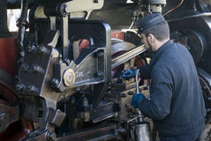 Mechanic by old train Stock Photography