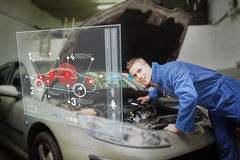 Mechanic with open hood consulting interface Stock Photography