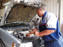Mechanic Performing a Routine Service Inspection stock images