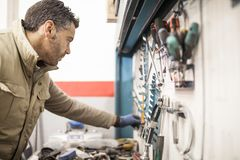 The mechanic works in the workshop stock image