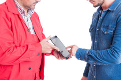 Mechanic or plumber and client using wireless tablet Stock Photo