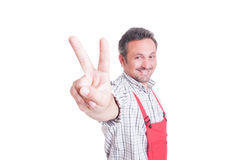 Mechanic or plumber showing victory or peace gesture Stock Image