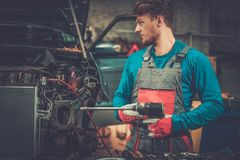 Mechanic with pneumatic tool Stock Image