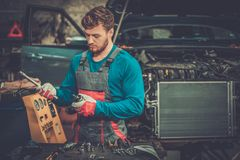 Mechanic with pneumatic tool Royalty Free Stock Images