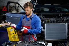 Mechanic with pneumatic tool Stock Photography