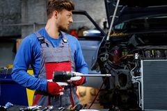 Mechanic with pneumatic tool Royalty Free Stock Photo