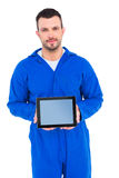 Mechanic pointing on digital tablet Stock Photo