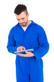 Mechanic pointing on digital tablet. On white background Royalty Free Stock Photos
