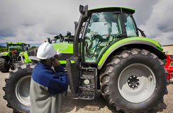 Mechanic pointing at large tractor Royalty Free Stock Photography
