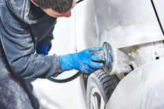 Mechanic polishing car body Royalty Free Stock Photos