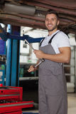 Mechanic posing with a ratchet wrench Royalty Free Stock Photo