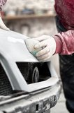 Mechanic prepairing the body of a car Royalty Free Stock Images