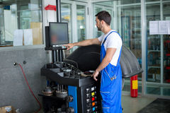 Mechanic prepares a balance machine Royalty Free Stock Image