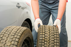 Mechanic is preparing Tire fitting service wheels Royalty Free Stock Photo