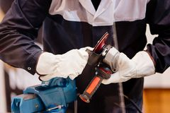 Mechanic in protective gloves changing cutting disc Stock Photo