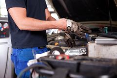 Mechanic Putting on Work Gloves Stock Image