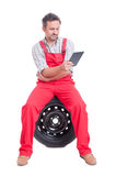 Mechanic reading from wireless tablet Stock Photos