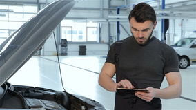 Mechanic records car problems to the tablet stock video