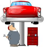 Mechanic & A Red Car. This illustration depicts a mechanic working on an old red car raised on a lift Royalty Free Stock Photography