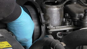 Mechanic removing camshaft pulley stock video footage