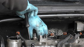 Mechanic removing engine part stock video