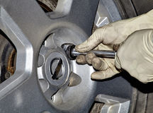 Mechanic Removing Lug Nut Stock Images