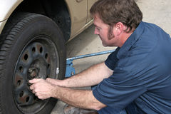 Mechanic Removing Lug Nuts royalty free stock photography