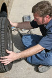 Mechanic Removing Tire Royalty Free Stock Images