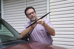 Mechanic Removing Worn Out Windshield Wipers Royalty Free Stock Photo