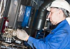 Mechanic repair engine Stock Photos