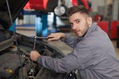 Mechanic repair the engine Stock Photos