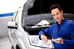 Mechanic at the repair shop Royalty Free Stock Photography