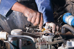 Mechanic repair vehicle Royalty Free Stock Image