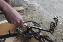 Mechanic repairing a bike, chainring and pedals Royalty Free Stock Photography