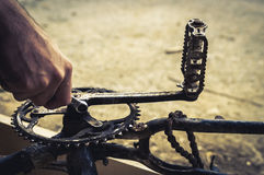 Mechanic repairing a bike, chainring and pedals Royalty Free Stock Photos