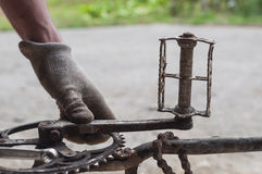 Mechanic repairing a bike, chainring and pedals Stock Photography