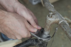Mechanic repairing a bike, handlebar Stock Photos