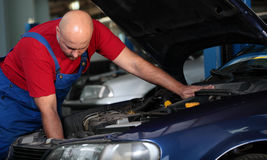 A mechanic repairing a car stock images