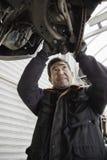 Mechanic repairing a car Royalty Free Stock Photo