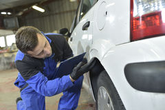 Mechanic repairing car Stock Photography