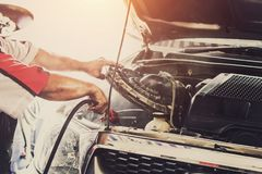 Mechanic repairing a car with Clean the dust Stock Photography