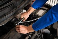 Mechanic Repairing Car Stock Photo
