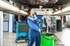 Mechanic Repairing Car On Hydraulic Lift Stock Photography