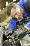 Mechanic repairing car motor Stock Photo