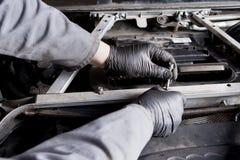 Mechanic repairing electric generator, repair of starter Stock Image