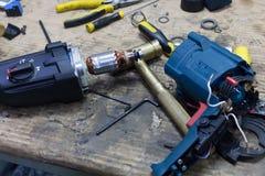 Mechanic repairing electrical starter Stock Image