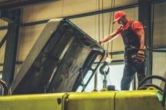 Mechanic Repairing Excavator royalty free stock photos